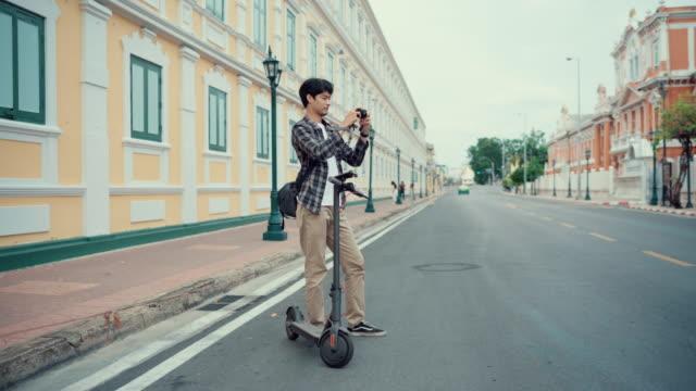 traveler is photographing of local landmark in bangkok thailand - local landmark stock videos & royalty-free footage