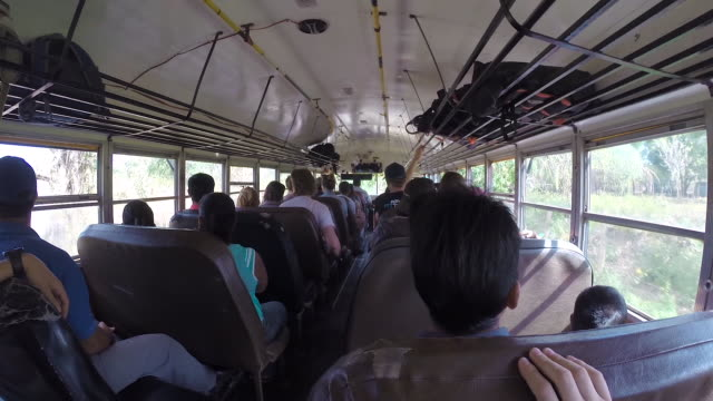 pov traveler man in a chicken bus of central america. ometepe island, nicaragua. - passenger point of view stock videos & royalty-free footage