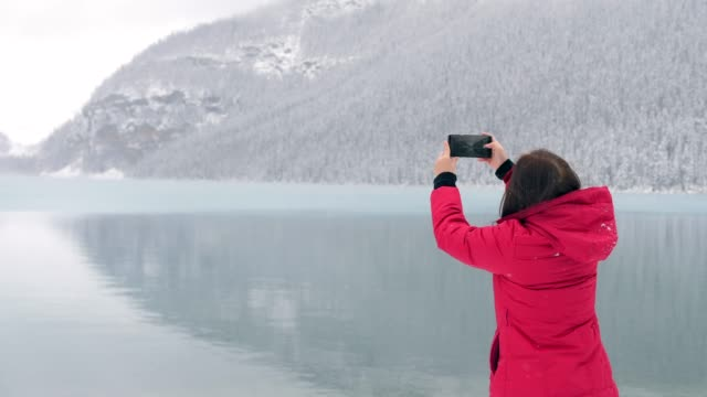traveler take a photo of lake louise - banff national park stock videos & royalty-free footage