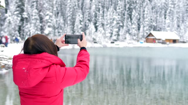 traveler take a photo of lake louise - banff stock videos & royalty-free footage