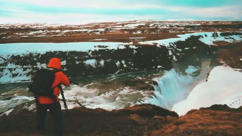 traveler take photo at gullfoss waterfall in iceland - glacier stock videos & royalty-free footage