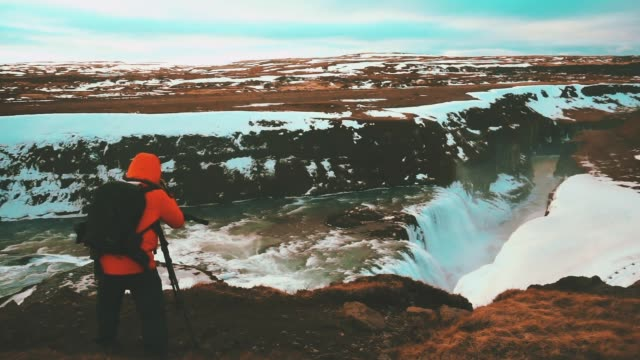 traveler take photo at gullfoss waterfall in iceland - iceland stock videos & royalty-free footage