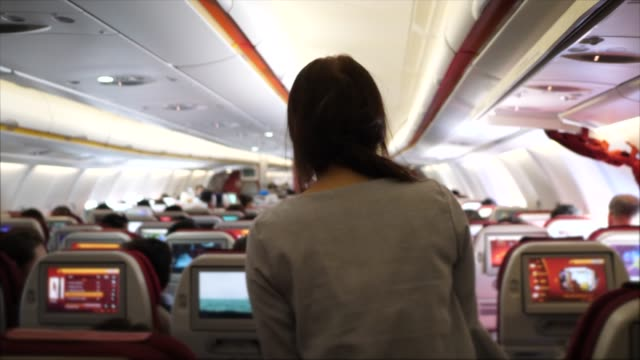 traveler walking through airplane - abitacolo video stock e b–roll