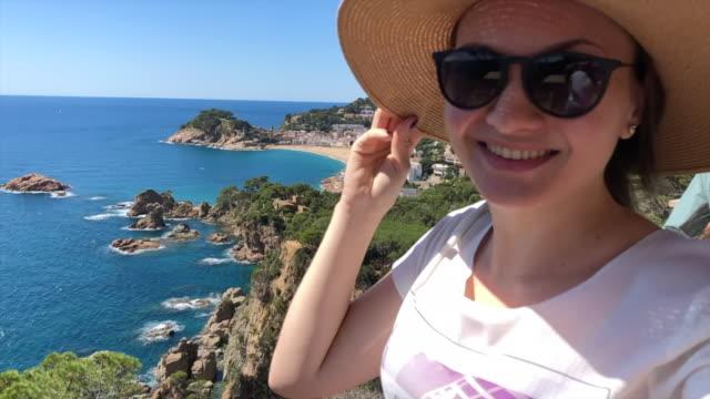 traveler woman with hat in a windy day contemplating the coastline of costa brava. - mar bildbanksvideor och videomaterial från bakom kulisserna