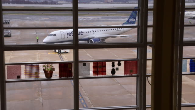 travelers and aircraft at ronald reagan national airport in arlington virginia us on wednesday nov 27 2019 the trade association airlines for america... - ronald reagan washington national airport stock videos & royalty-free footage
