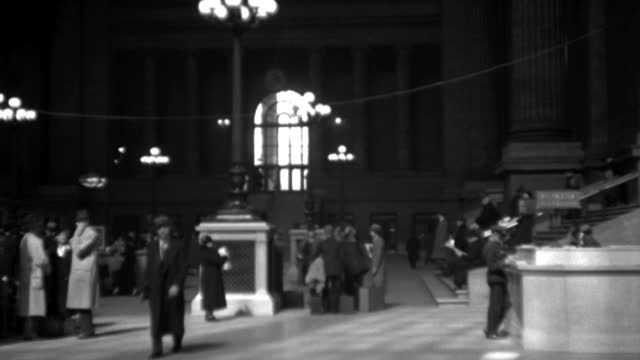 travelers ascend the stairway at pennsylvania station in new york city in 1936. - 1936 stock videos & royalty-free footage