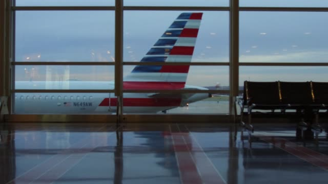 travelers at ronald reagan national airport the day before the thanksgiving holiday in washington dc us on wednesday nov 22 2017 photographer andrew... - ronald reagan washington national airport stock videos and b-roll footage