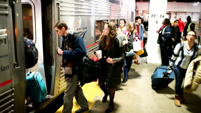 Travelers board an Amtrak train at Union Station on November 21 2018 in Chicago Illinois Fiftyfour million Americans are expected to travel this...