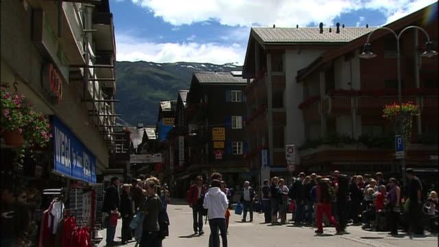 Travelers congregate in front of the Zermatt Railway Station.