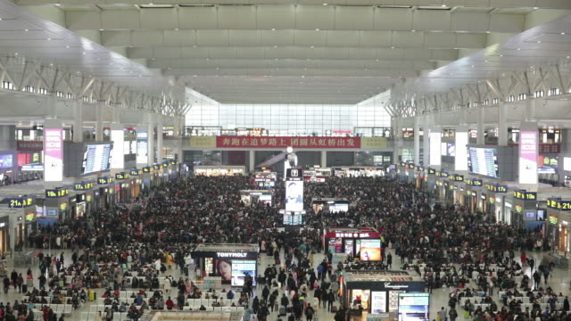 travelers crowd into the shanghai highspeed railway station as many are starting their annual migration to their home dor the upcoming chinese new... - dor stock videos & royalty-free footage