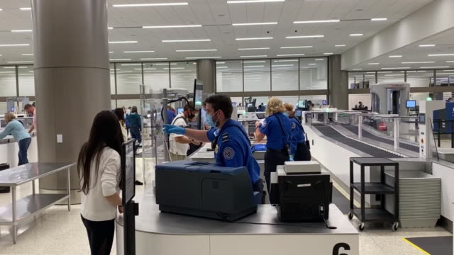 travelers go through the security screening center on opening day of the salt lake city international airport in salt lake city, utah, u.s. on... - utah stock videos & royalty-free footage