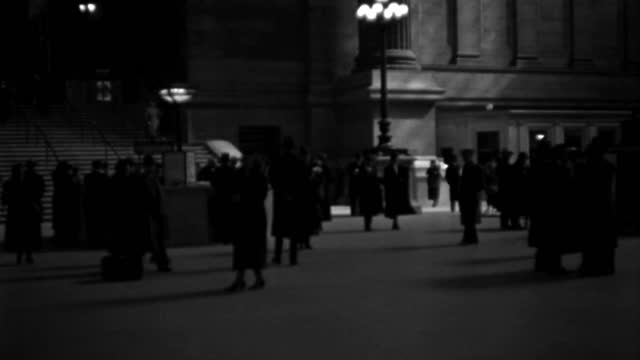 travelers pass through the lobby of pennsylvania station in new york city in 1936. - 1936 stock videos & royalty-free footage