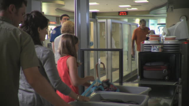 ms travelers pushing belongings through airport security checkpoint, appleton, wisconsin, usa - untersuchen stock-videos und b-roll-filmmaterial