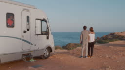 Travelers relaxing camping and enjoying traveling in recreational vehicle