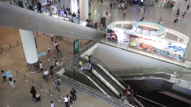 travelers ride the escalators of the shanghai hongqiao railway station in shanghai, china, on tuesday, sept. 29, 2015 shots: passengers wait in the... - push in stock videos & royalty-free footage