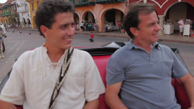 MS Travelers riding by horse carriage / Cartagena, Bolivar, Colombia