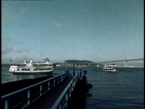 1975 MONTAGE Travelers, some with bicycles, boarding ferry to Seattle at Port of San Francisco / California, United States