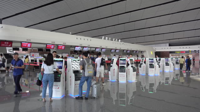 travelers type boarding tickets on self-service machines in beijing daxing international airport, which officially began to operate on september... - transportation building type of building stock videos & royalty-free footage