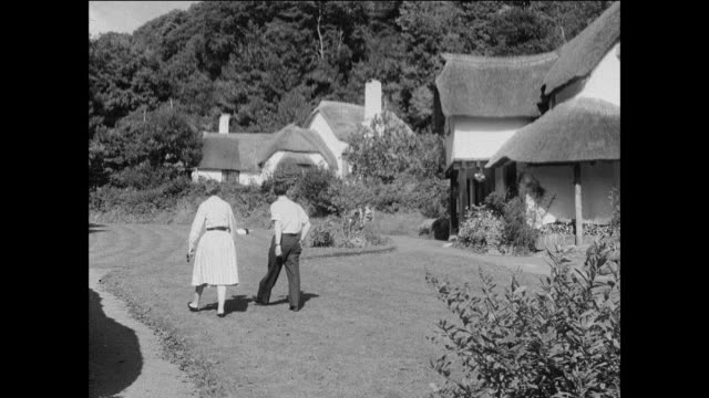 distant travelers visit country villages in exmoor national park / uk - stone house stock videos & royalty-free footage