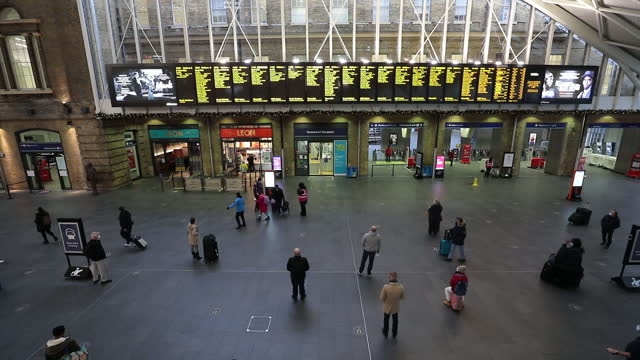 travelers wait at king's cross railway station in london, uk on monday, december 21, 2020. more than 16 million britons are now required to stay at... - public transport stock videos & royalty-free footage
