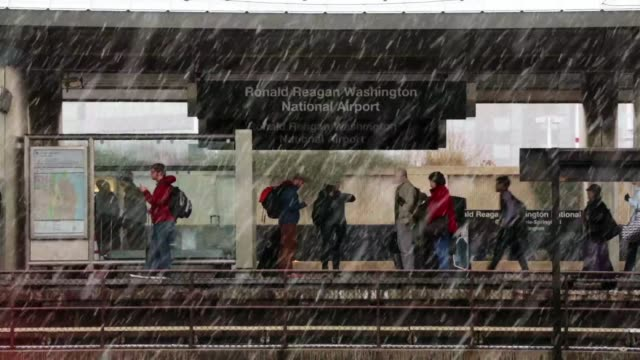 travelers wait for metro train in the snow at ronald reagan washington national airport metro station after they have landed in washington on the day... - ronald reagan washington national airport stock videos and b-roll footage