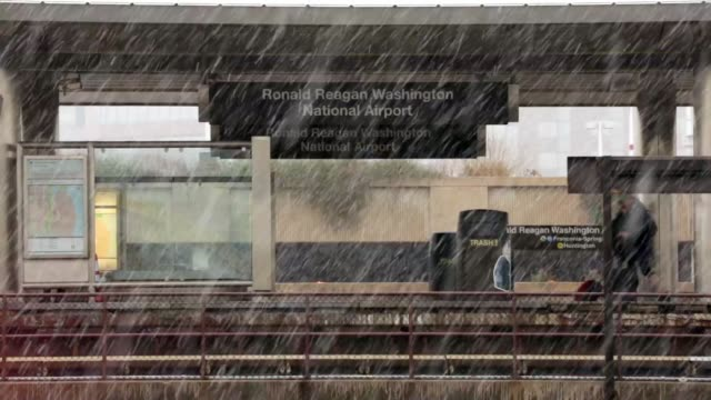 travelers wait for metro train in the snow at ronald reagan washington national airport metro station after they have landed in washington on the day... - flughafen washington ronald reagan national stock-videos und b-roll-filmmaterial
