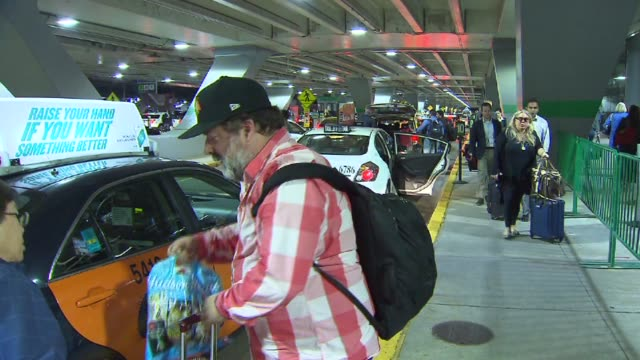 travelers wait in line at a taxi stand at o'hare airport on sept 13 2014 in chicago - taxi stand stock videos and b-roll footage