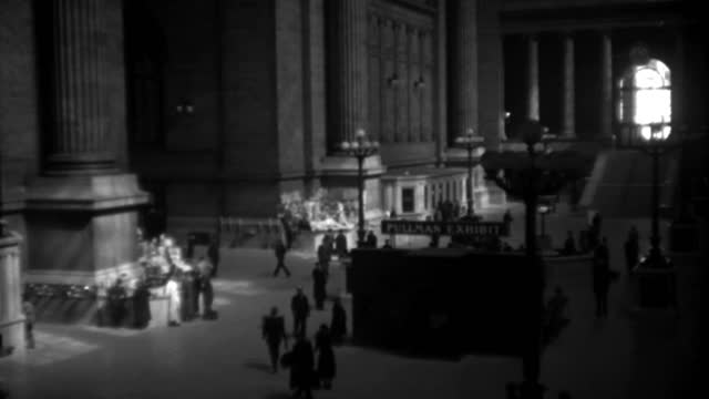 travelers walk near the pullman exhibit at pennsylvania station in new york city in 1936. - 1936 stock videos & royalty-free footage