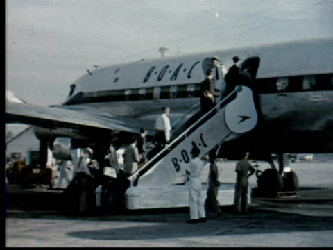 1957 montage travelers walk out to + board boac airplane. propellers start. klm lockheed l49 constellation flying dutchman taxis. boac constellation takes off / singapore / audio - 1957 stock videos & royalty-free footage