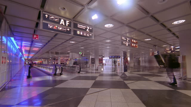 Travelers walk through an airport terminal in Munich, Germany.