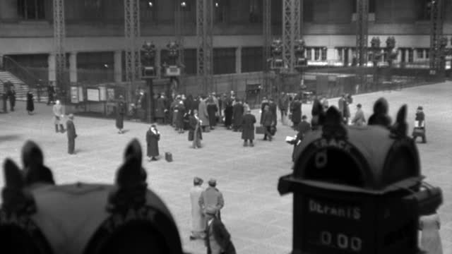 travelers walk through the lobby of pennsylvania station in new york city in 1936. - 1936 stock videos & royalty-free footage