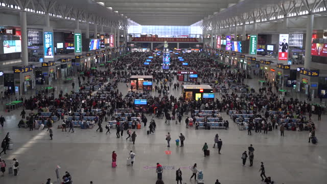 travelers walk through the main hall of the hongqiao railway station ahead of lunar new year in shanghai, china, on friday, jan. 15, 2021. china's... - chinese culture stock videos & royalty-free footage