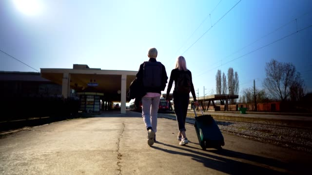 travelers walking with suitcase - railway station platform stock videos & royalty-free footage