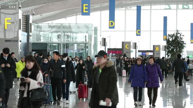 Travelers with luggage walk through the terminal 2 building at Incheon International Airport in Incheon South Korea on Thursday Jan 18 2018