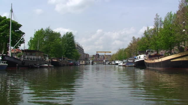 traveling along an amsterdam canal - boat point of view stock videos and b-roll footage
