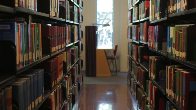 Traveling along bookshelves in library