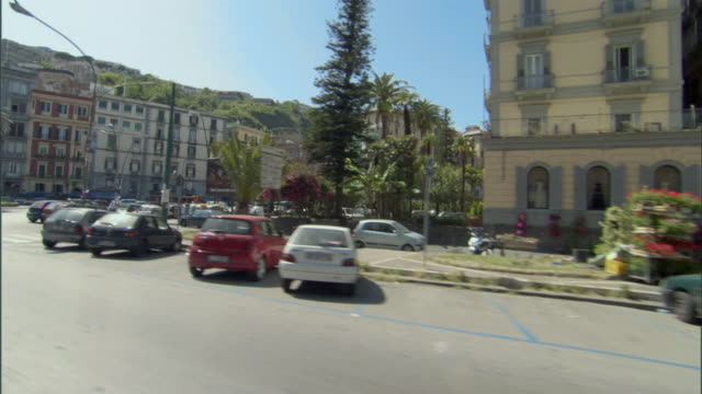 ws pov pan traveling along busy road in town center in naples / naples, campania, italy  - ナポリ点の映像素材/bロール