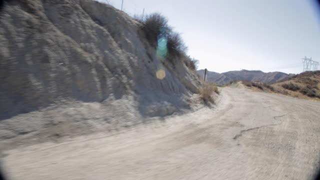 pov traveling along dirt mountain road / santa clarita, california, united states - santa clarita stock videos & royalty-free footage