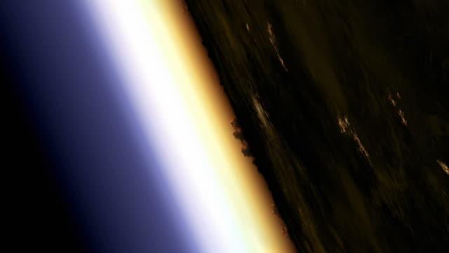 vídeos y material grabado en eventos de stock de traveling at a slant towards sun glow on earth's horizon as if seen from space - artbeats