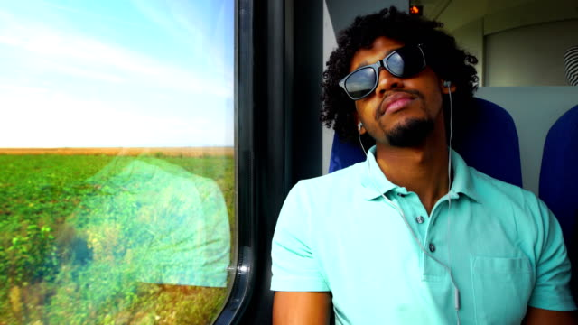 traveling by train through a countryside. - in ear headphones stock videos & royalty-free footage