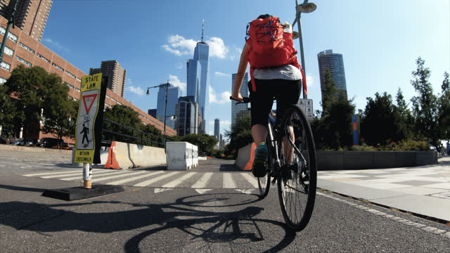 traveling in usa: woman pov bicycle riding with road bike in new york - motorcycle biker stock videos & royalty-free footage