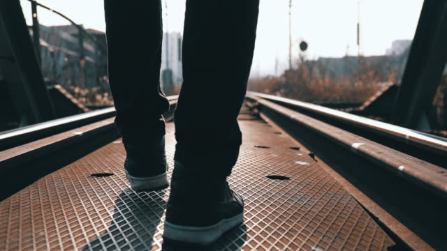 traveling man walking on the railroad track - human foot stock videos & royalty-free footage