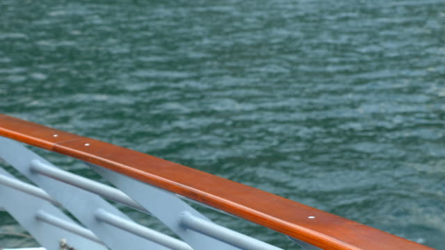 Traveling on a ferry in a luxury resort town near Lake Como, Italy, Europe. - Slow Motion
