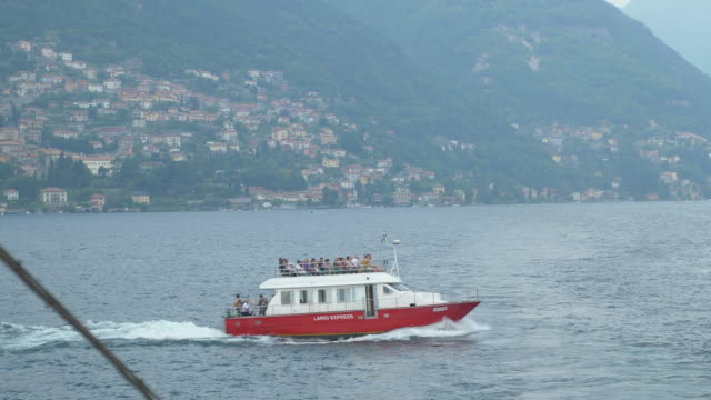 Traveling on a ferry on Lake Como, Italy, Europe. - Slow Motion