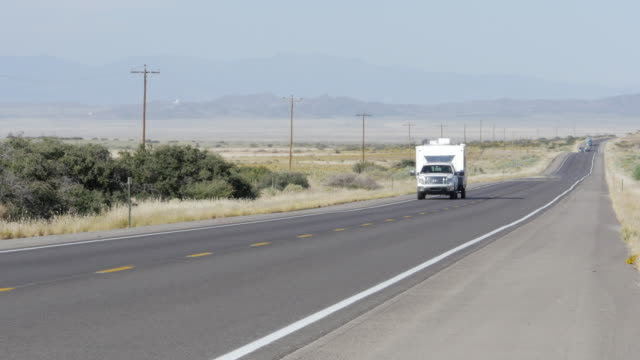 traveling on us country road. - camper trailer stock videos and b-roll footage
