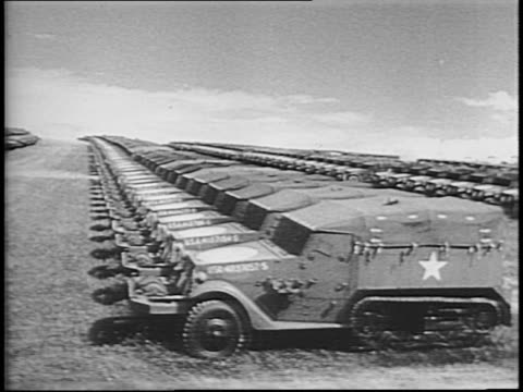 Traveling past parked tanks and trucks / montage of huge numbers of parked jeeps tanks and guns