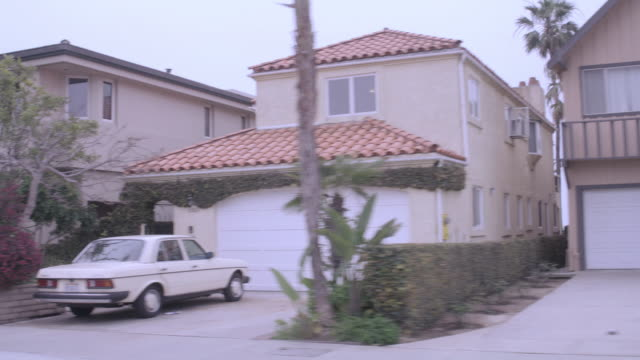 pov traveling past two-story contemporary homes in an upscale, suburban neighborhood / united states - zweistöckiges wohnhaus stock-videos und b-roll-filmmaterial