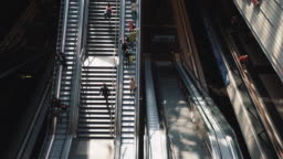 Traveling people on stairs and escalator, Berlin, Germany