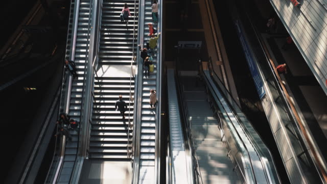 traveling people on stairs and escalator, berlin, germany - steps and staircases stock videos & royalty-free footage