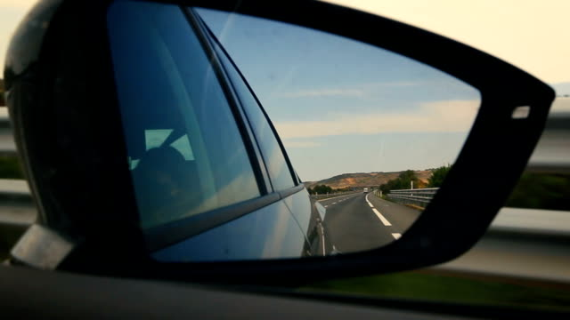 traveling. reflector of the road in the rearview mirror of the car. - wing mirror stock videos & royalty-free footage